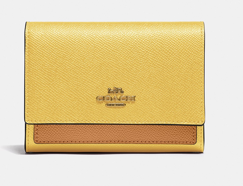 コーチ、黄色×ベージュの財布