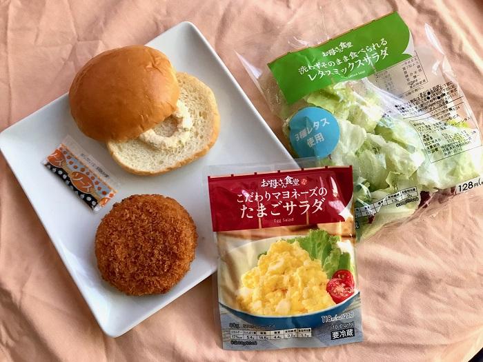 『ファミリーマート』の商品「ファミチキバンズ(タルタルソース)」、「北海道グラタンコロッケ」、「こだわりマヨネーズのたまごサラダ」、「レタスミックスサラダ」を並べた写真