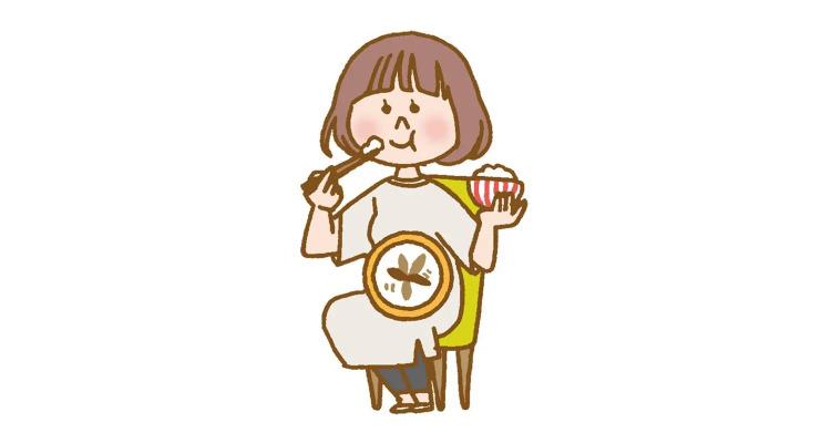 女性がご飯を食べているイラスト